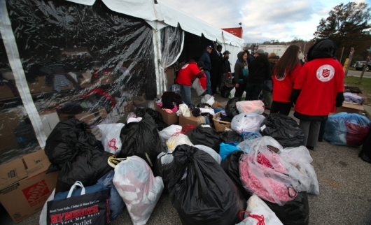 The American Red Cross and Salvation Army help hurricane Sandy victims on Staten Island, NY, with donated materials in Nov. 2012. Credit Andy Katz / iStock