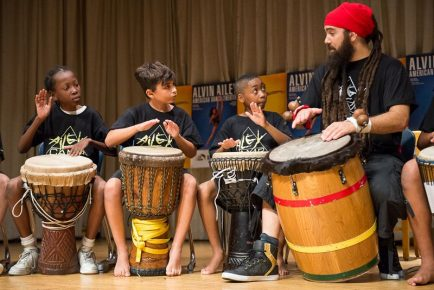 Kids playing the drums at Ailey Camp in Washington Heights