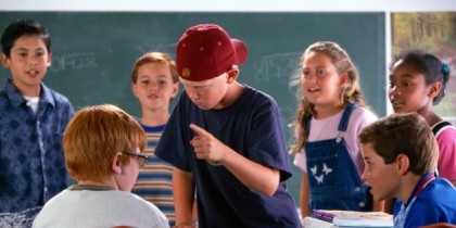 Children Picking on Child in Classroom