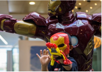 "Boy with his ""Avengers""-themed hand prosthetic."
